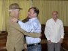 Anti-terrorist Fighter Fernando Gonzalez Back in Cuba. Fernando Gonzalez greets Minister of Interior General Abelardo Colomé Ibarra. José Ramón Machado Ventura (R), second secretary of the Central Committee of the Commmunist Party of Cuba was also present in the encounter. (Photo taken from Cubadebate)