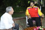 Raul Castro and Nicolás Maduro.