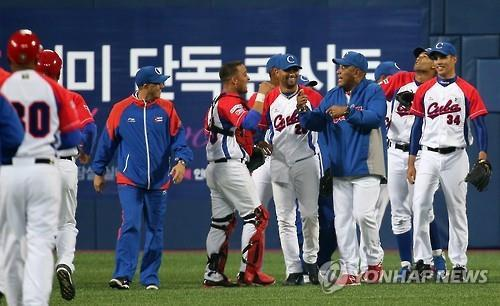 Cuban players celebrate their 3-1 victory over South Korea. Photo taken from http://english.yonhapnews.co.kr