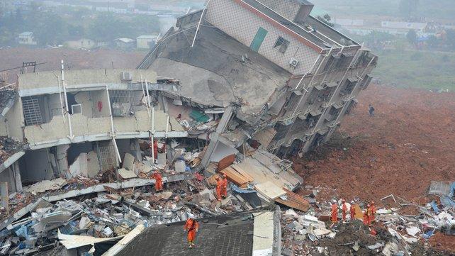 Chinese Rescuers Keep Searching for Survivors after Landslide. Photo taken from  http://www.rte.ie