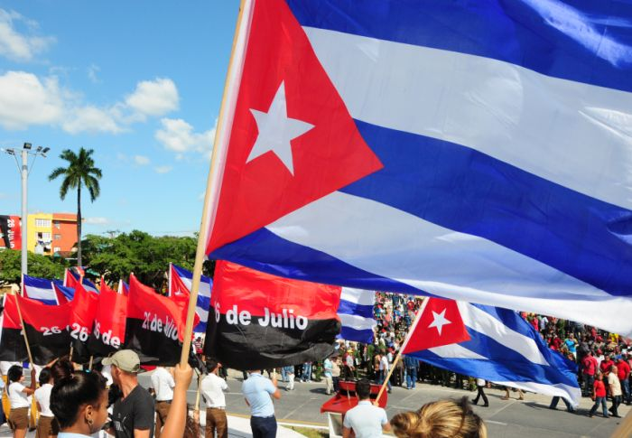 cuban youth with flags