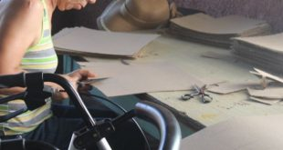 Disabled woman in workshop