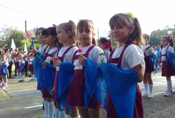 First graders during the ceremony in which they will receive the blue scarf