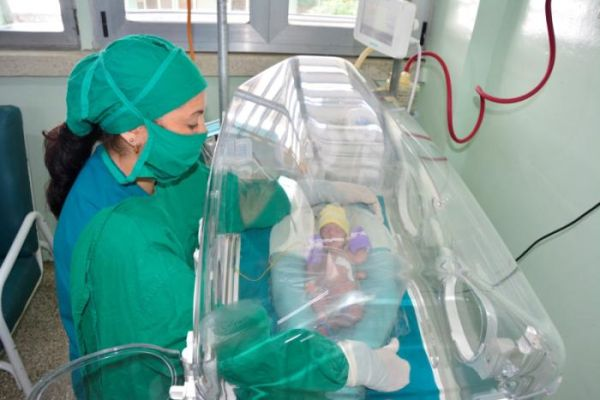 A nurse looks after a baby in the neonatology ward in the provincial hospital of Sancti Spiritus