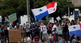 A protester flies a Panama flag during a student protest in front of the National Assembly in Panama City, Panama, Oct. 31, 2019