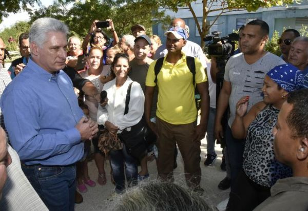 Díaz-Canel talks to local residents during his visit to Ciego de Avila.