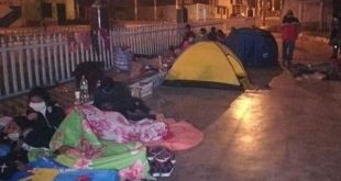 peruvians spending the night outside a hotel