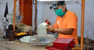 sancti spiritus, mechanic in repair shop
