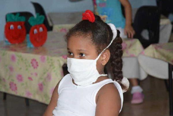 child wearing face mask, sancti spiritus, cuba