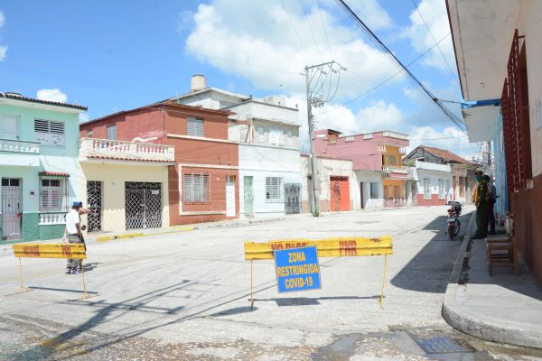 Authorities watch over a restricted area in the city of Sancti Spiritus