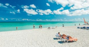 Tourists enjoy the sun, the sea and the sand in Varadero resort