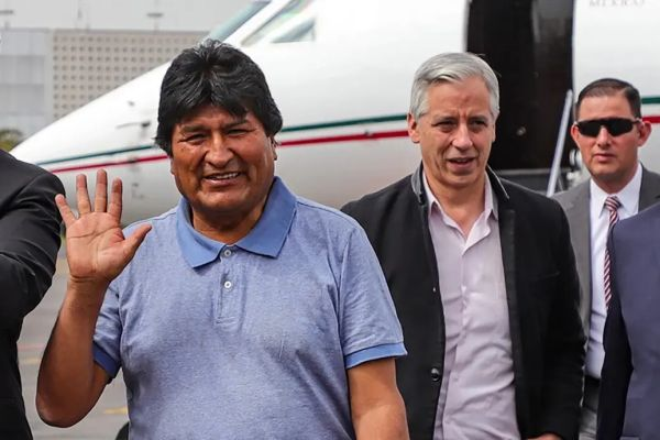 evo morales is with alberto fernandez upon arrival in argentina after coup
