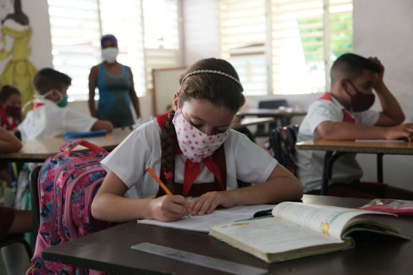 Primary education students attending a class in one of the schools of sancti spiritus, in central Cuba