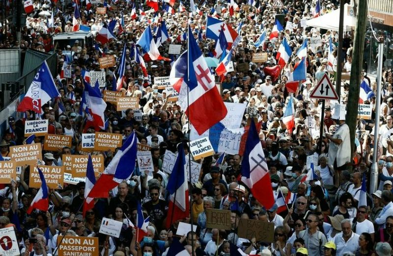 people march in france against covid health pass