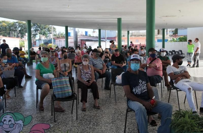 people waiting to be vaccinated
